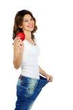 在白色隔绝的愉快的减重妇女 免版税库存照片