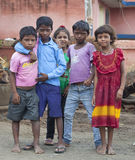 愉快的印地安小学生 免版税库存照片