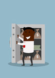愉快的商人打开有金钱的保险柜 库存图片