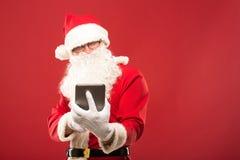 愉快的圣诞老人画象有一个巨大的大袋的 免版税库存照片