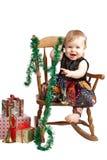愉快的圣诞节在补缀品礼服的婴孩岩石 免版税库存图片