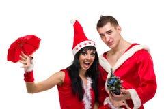 愉快的圣诞节夫妇,被隔绝在白色 免版税库存照片