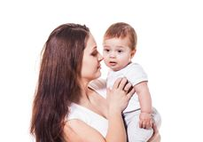愉快的在白色隔绝的母亲和婴孩 库存照片