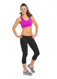 愉快的健身少妇全长画象  免版税库存照片