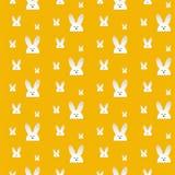 愉快的复活节兔子兔宝宝橙色无缝的背景 免版税库存照片