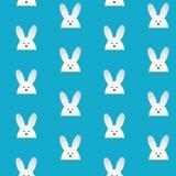 愉快的复活节兔子兔宝宝蓝色无缝的背景 免版税库存图片