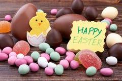 愉快的复活节卡片和甜点 库存照片