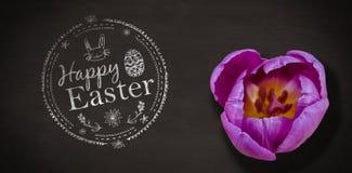 愉快的复活节白色商标的综合图象反对黑背景的 免版税库存照片