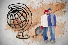 愉快的夫妇的综合图象在温暖的衣物的 免版税图库摄影