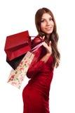 愉快的女孩举行购物袋。 免版税库存图片