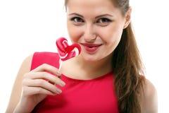 愉快的女孩用焦糖 库存图片