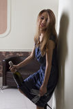 愉快的女孩用香槟和长笛 免版税库存图片