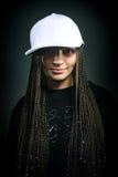 愉快的女孩画象有dreadlocks的在盖帽 免版税图库摄影