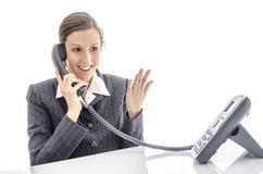 愉快的女实业家联系在电话 免版税图库摄影
