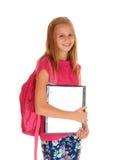 愉快的女小学生准备好学校 免版税库存照片