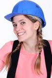 愉快的女性建造者 免版税库存照片