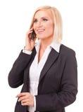 愉快的女性执行委员发表演讲关于移动电话 图库摄影