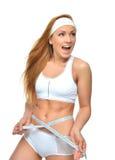 愉快的女性测量腰部激动尖叫的叫喊 免版税库存图片