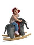 愉快的女婴在跷跷板摇摆 免版税图库摄影