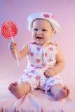 愉快的女婴棒棒糖 库存图片