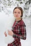 愉快的妇女在与雪的冬天 免版税库存照片