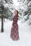 愉快的妇女在与雪的冬天 免版税图库摄影