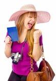 愉快的妇女持与票的一本护照 库存照片