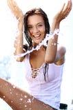 愉快的妇女湿在雨中 免版税库存照片