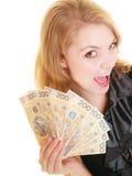 愉快的妇女藏品擦亮剂货币金钱钞票 免版税库存照片
