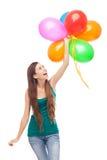 愉快的妇女藏品气球 免版税库存图片