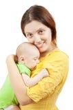 愉快的婴孩新出生她的母亲 免版税库存照片