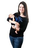 愉快的婴孩新出生她的藏品的妈妈 免版税库存照片