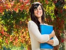 愉快的学员在秋天 免版税图库摄影
