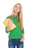 愉快的学员女孩纵向有书的 库存照片
