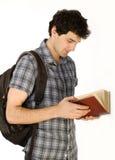 年轻愉快的学生运载的袋子和书 库存图片
