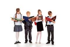 愉快的学童 免版税库存照片
