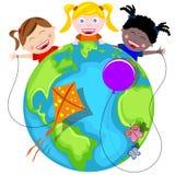 愉快的孩子和地球 免版税库存照片
