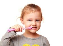 愉快的孩子女孩掠过的白色牙 库存照片