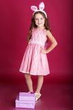 愉快的孩子穿桃红色礼服 免版税库存图片
