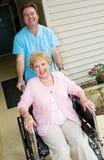 愉快的家庭看护居民 库存图片