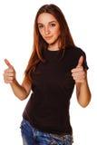 愉快的少妇女孩显示正号拇指 图库摄影
