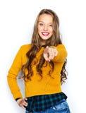 愉快的少妇或青少年的指向的手指在您 免版税库存照片