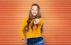 愉快的少妇或青少年的指向的手指对您 免版税库存图片