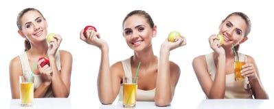 愉快的少妇用在白色背景的苹果汁 免版税库存图片