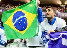 愉快的希腊支持者庆祝合格对世界杯足球赛2014年巴西 库存图片