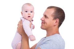 愉快的年轻父亲接近的画象有女婴的被隔绝 免版税库存照片