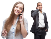 愉快的微笑的商人叫用移动电话 免版税图库摄影