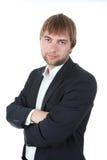 年轻愉快的微笑的商人画象 免版税图库摄影