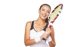 愉快的微笑的女性网球员画象有专家的 免版税库存照片