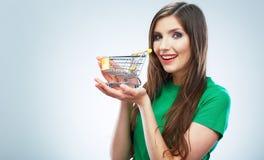 愉快的微笑的妇女举行购物车画象  女性mod 库存图片